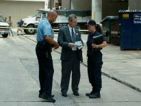 photo of public safety officer and two others conducting forensic investigation